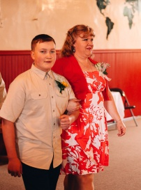 Young Groomsmen Escorting Mother of the Bride
