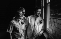 Groomsmen and Groom posing by the window, Wedding Portrait, Black and white Portrait