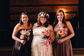 Bride and her Bridesmaids posing with Bouquets inside the church at wedding