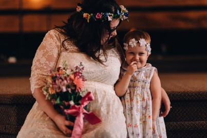 Bride and Little Girl candid picture at wedding