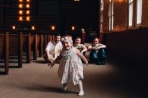 Little sister runs away joyfully from Groom and Groomsmen inside Church