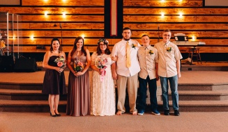 Wedding party inside the Church posing for a Portrait