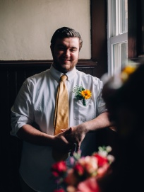 Moody Portrait Of Groom by the Window