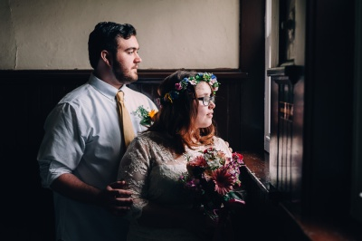 Beautiful and Moody Portrait Of Hipster Groom and Bride by the Window