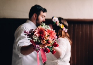 Beautiful and Moody Portrait Of Hipster Groom and Bride with Bouquet in the Middle