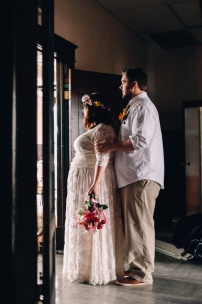 Hispter Bride and Groom Wedding Portrait by door frame in color