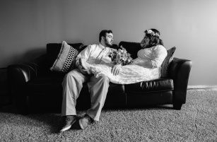 Hispter Bride and Groom Black and White Wedding Portrait sitting on couch