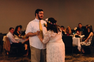 Hipster Bride and Groom Dance at Wedding Reception