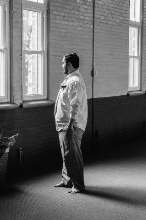 Black and White Wedding Portrait of Groom Looking at the window
