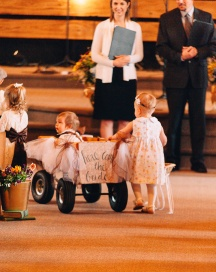 Small Children with Cart that Says here comes the Bride