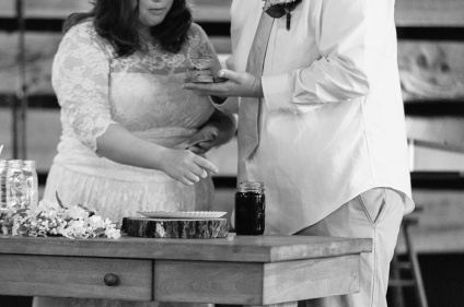 Bride and Groom have PB J Sandwich for First Communion in a Black and White Picture