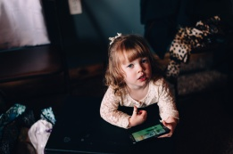 Candid moody picture of Little girl playing with her toys before wedding ceremony in Erie, Pa