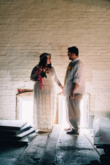 Moody Wedding Portrait of Hipster Couple with Light from Behind