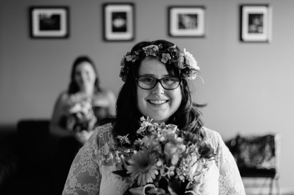 Black and White Wedding portrait of bride with her maid of honor in the back
