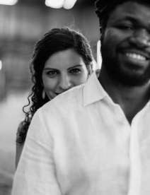 Beautiful Black and White Portrait of Woman looking Behind the shoulder of her Fiance