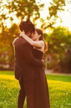 Couple Kissing For Portrait in Golden Hour