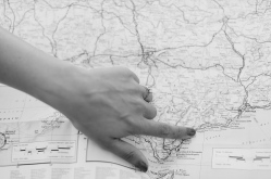 Black and White Photo of Girl with Engagement Ring Pointing at map of Spain