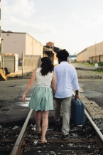 Engagement Portrait of Couple walking on Railroad Rails