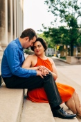 Beautiful Engagement Portrait of couple closing their eyes while sitting in steps