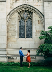 Engagement Portrait of Couple underneath a big window in Heinz Chapel