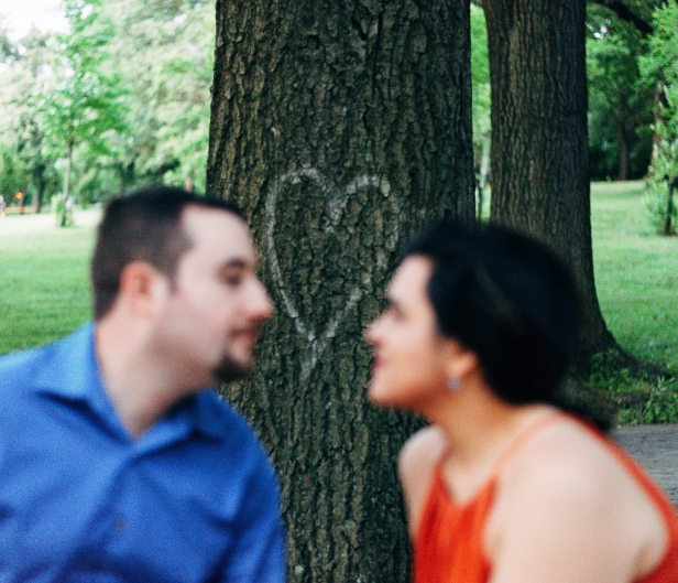 Portrait of couple with a heart graffiti in between them