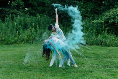 Posing while throwing Paint in the air at Engagement Session in Pittsburgh
