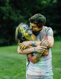 ngaged Couple Holding and Kissing Each other Covered in Powder Paint