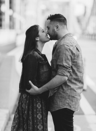Black and White Portrait of man kissing her fiancee in Downtown Pittsburgh
