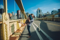 Super Cute Portrait of couple in a middle of the Clemente bridge kissing