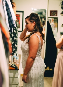 Bride looking at the mirror and smiling