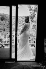 Black and White Portrait of Bride looking at Groom coming