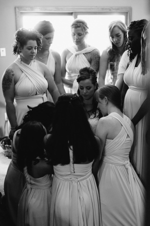 Black and White Portrait of Bride and Bridesmaids praying