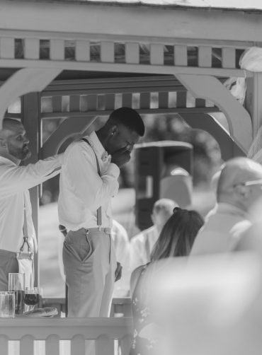 Black and White Candid Photo of Groomsmen crying when he sees Bride coming to altar