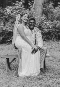 Black and White Portrait of Bride sitting with Groom