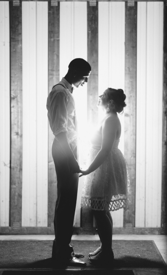 Backlite Black and White Portrait of Groom and his Bride