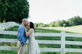 Beautiful Portrait of Couple kissing in front of a white fence