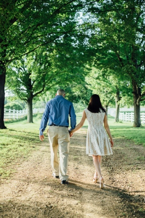 Beautiful Portrait of Couple walking away underneath tree canopy