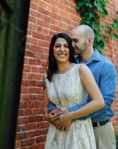 Portrait of couple kissing and smiling at camera